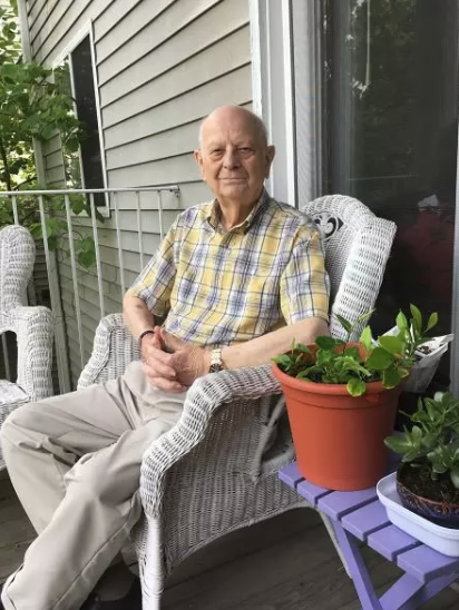 Pastor sitting in chair on porch